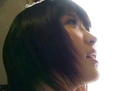 Asian beauty filmed by a horny down blouse voyeur.
