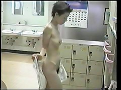 The whole body of amateur is nude on dressing room spy cam