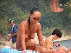 Hard Nipples on hot Asian in a voyeur nudist beach video