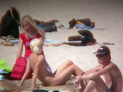 Smoking hot blonde on hidden beach cam
