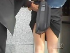 Business man attached his bag to her for skirt sharking.