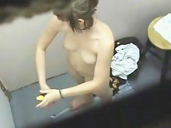 Nude dressing room girl covers the body with aroma spray