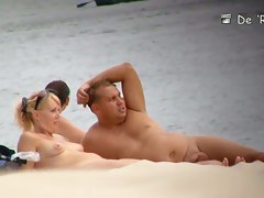 Blonde mature chick is naked at the beach