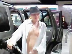 Sexy petrol station worker teases clients with naked charms