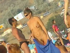 Real amateur beach nudist voyeur vid