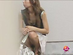 Asian babe waiting for friends gets a skirt sharking.