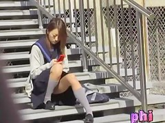 Asian schoolgirl on a break got skirt sharked while texting