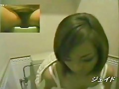 Toilet cam closeups with chick rubbing her big clitoris