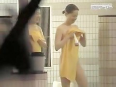Hidden cam in the shower shooting nice Asian bodies