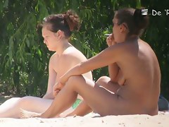 Pale and tanned saggy tits galore in this beach voyeur video