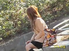 Japanese sharking video of a cute gal sitting in a park