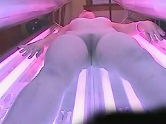 Flabby blonde stripping before solarium voyeur candid video