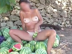 Curvy MILF in public masturbation action with watermelons