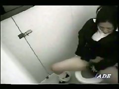 Japanese gal gets her hairy pussy spied by voyeur toilet cam