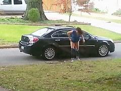 Girl caught on voyeur cam pissing on the car wheel