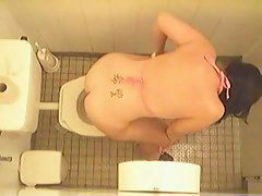 Toilet pissing girl in bikini spied on the voyeur cam
