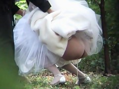 Beautiful bride is pissing outdoor on the piss spy video