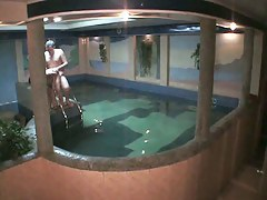 Naked amateur couple having sex in the pool in free voyeur clip