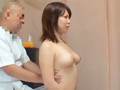 Japanese babe gets fingered during erotic massage session