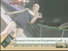 Blonde and brunette dancers in short dresses flash their sexy asses on live TV