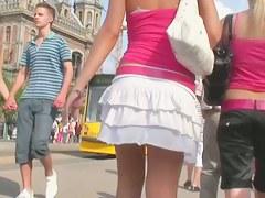 Voyeur cam takes a peek under a skirt of a blonde hottie