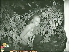 Cocky blonde pissing in the forest and getting filmed at night
