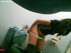 Pissing girls are filmed in the bathroom