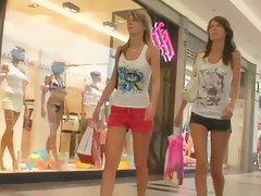 Four extremely hot sexy legs in this street candid video