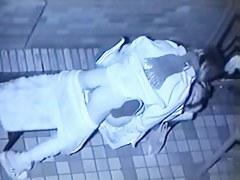 Voyeur sex video catches Asian couple fucking on bench