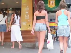 Scantly clad teens in this non-nude street voyeur video