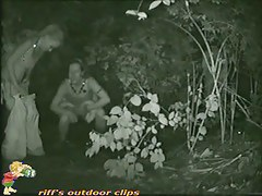Piss porno filmed outside in a spot with low growing vegetation