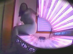Naked and completely sexy voyeur action in the tanning booth