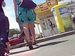 Smooth legs with a sexy tattoo in this street upskirt video