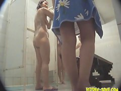 Shower room spy scenes of girls washing each other