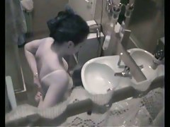 College chick was filmed in the shower by her crazy neighbor