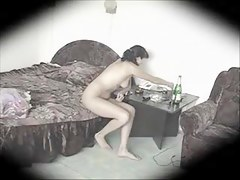 Voyeur cam shooting the nude girl alone in the bedroom